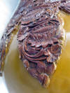 close view of gourd tumba carving